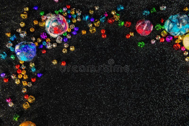 Colourful wool Christmas baubles and above view. Copy space. royalty free stock photo