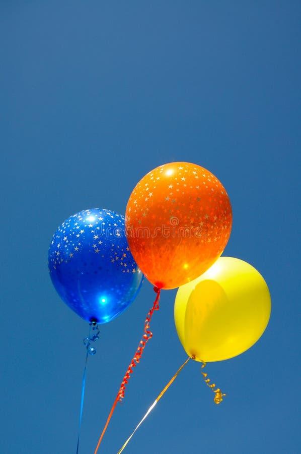Colourfull balloons against blue sky. stock photos