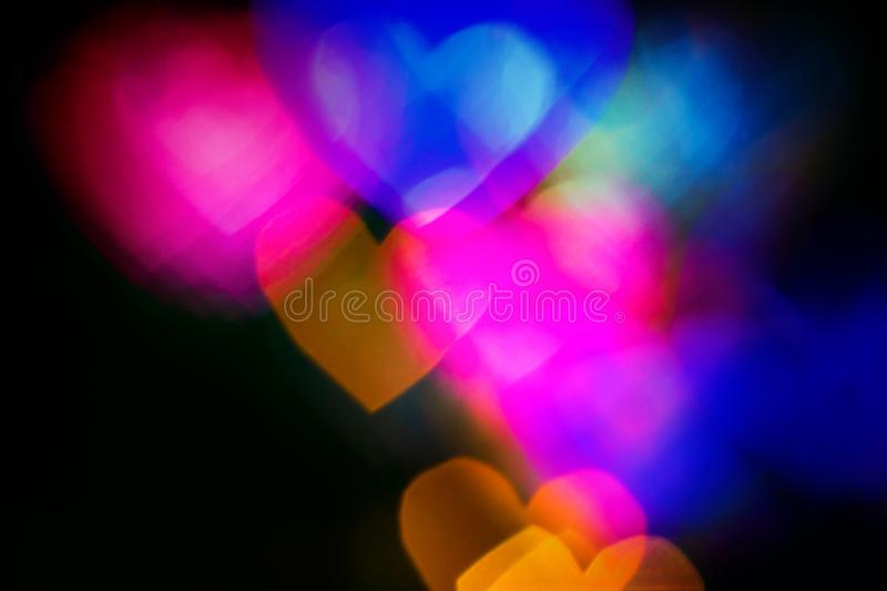 Colourfull heart bokeh background. Colourful blurred heart bokeh background. For Christmas and Valentine`s day banners and social networks, greeting cards royalty free stock photography