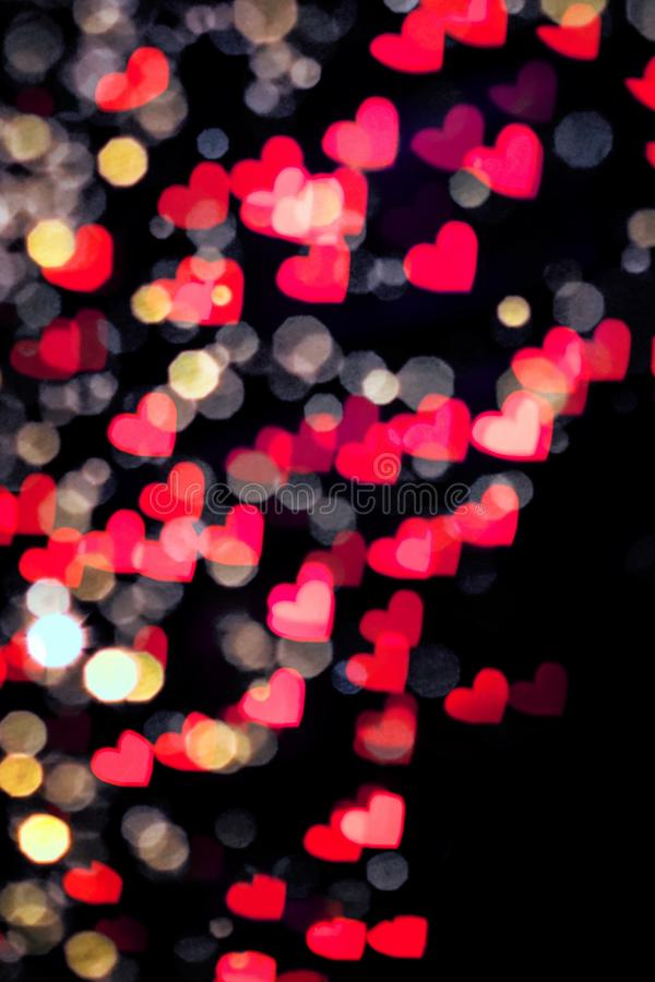 Colourfull heart bokeh background. Colourful heart bokeh festive glitter background. Christmas and Valentine's day greeting cards, invitations, flyers stock photo