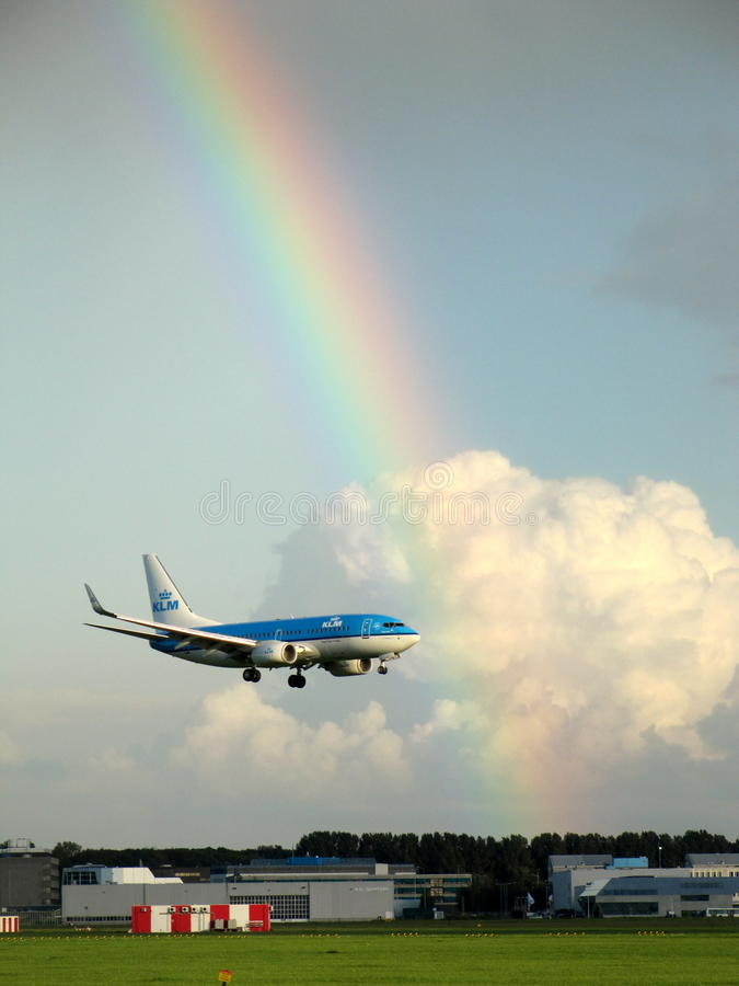 Colourfull sky. A nice colourfull sky with an airplane of the KLM airline business and on the background a nice coloured rainbow (picture made on august 29th royalty free stock images