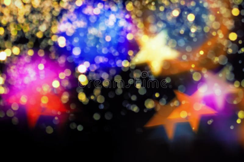 Colourfull stars bokeh background. Colourful stars bokeh festive glitter background. Christmas greeting cards, invitations, flyers, blog posts, banners design stock photos
