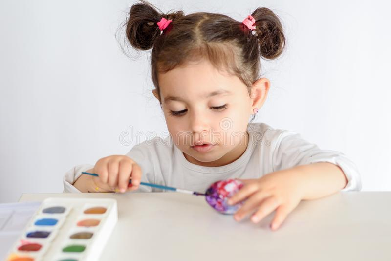 Colouring eggs for easter time at home. stock photo