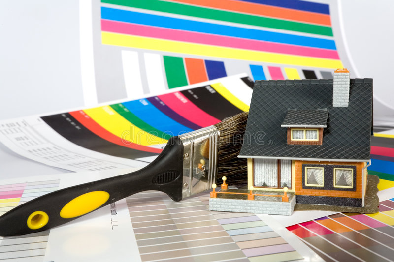 Colouring of the house by a paint. Colouring of the constructed house by a paint stock photos