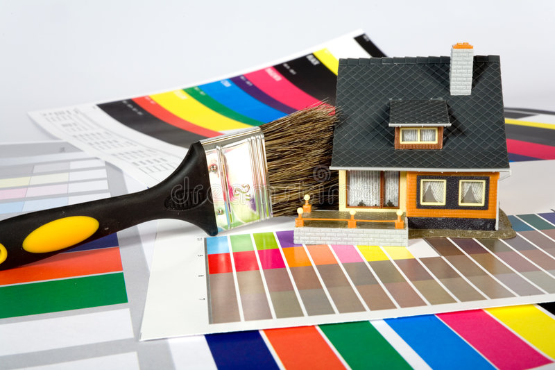 Colouring of the house by a paint. Colouring of the constructed house by a paint stock images