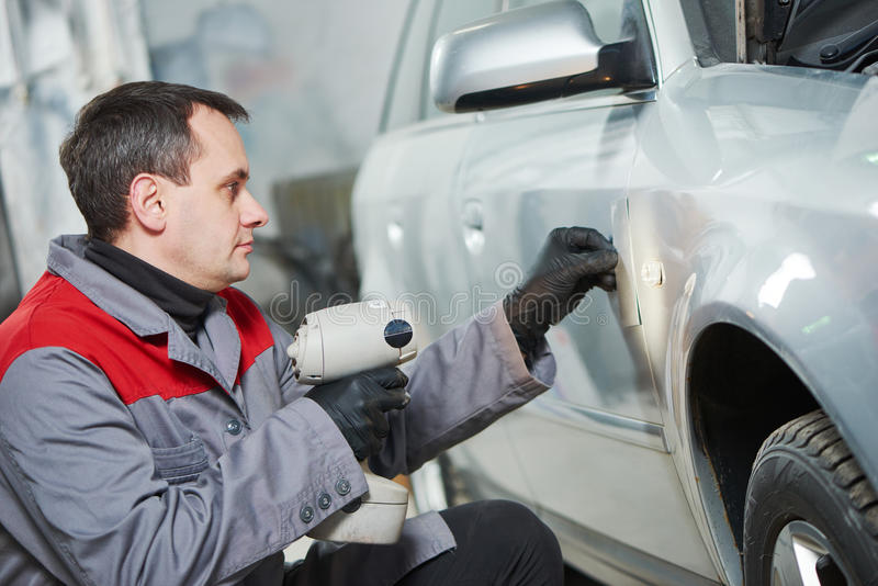 Colourist man compare color sample with car paint stock photos