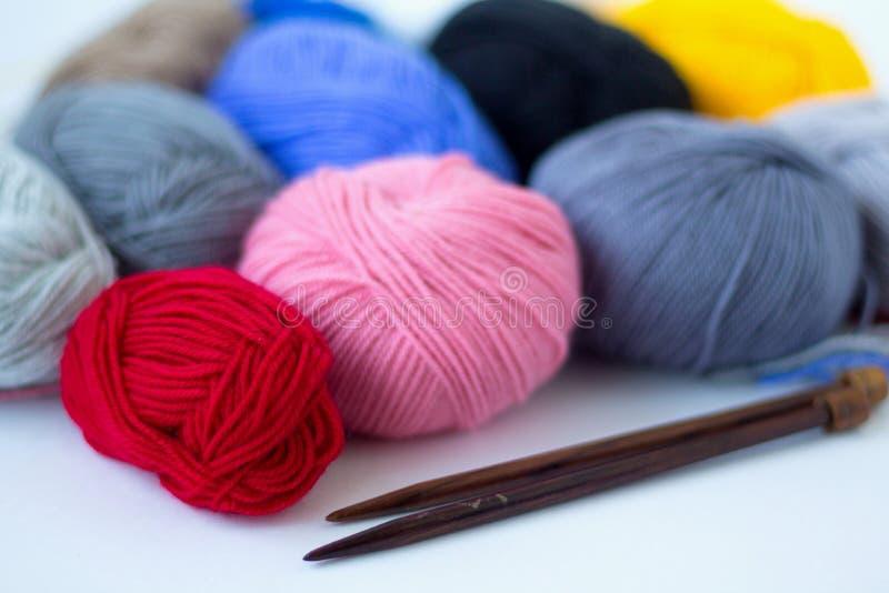 Colours balls of yarn and knitting needles  on white background stock image