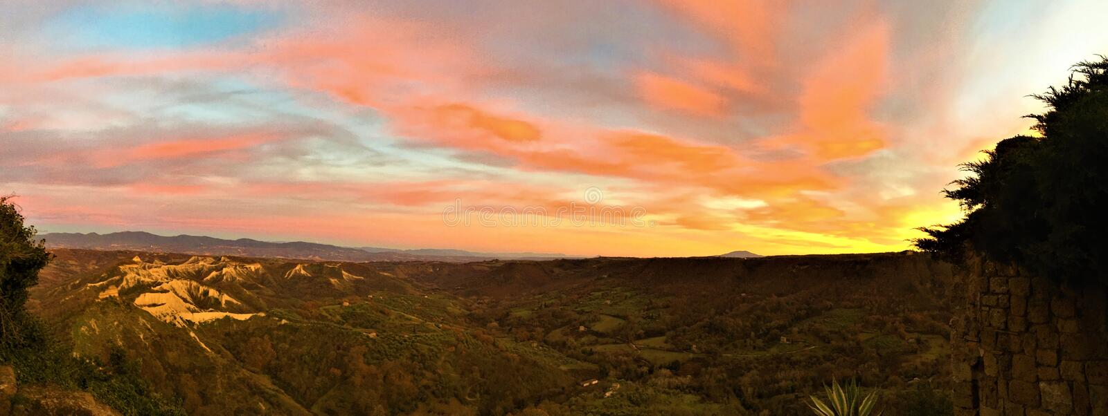 Colours explosion, sunset, sky, light, freedom, romantic and magic landscape, infinite land in Viterbo province, Italy. Colours explosion, sunset, nature, sky stock photo