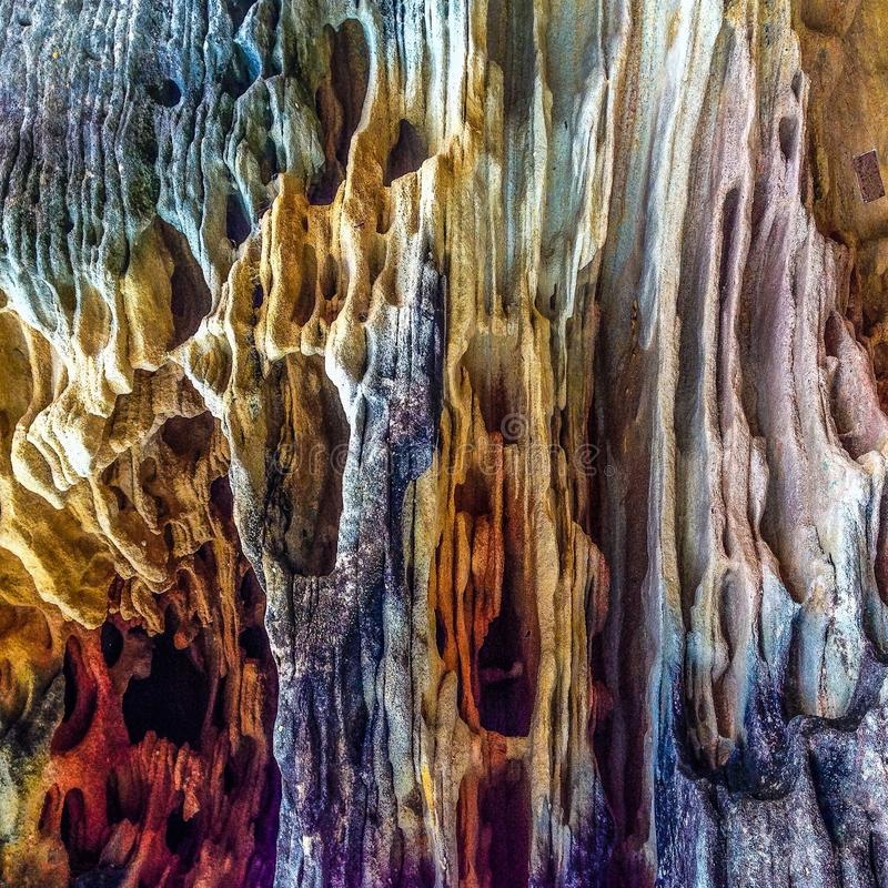 Colours on rock. Colourful rock formation on the cliff royalty free stock images
