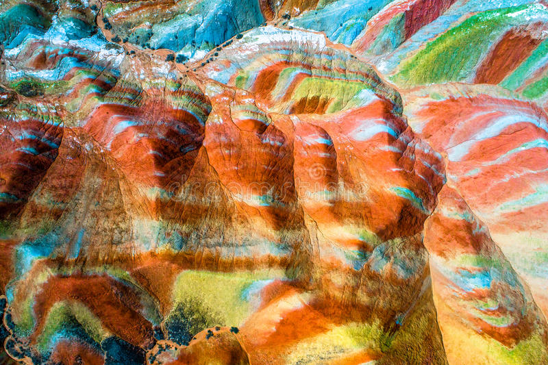 Colorful pattern on rainbow mountains. Colorful Rainbow Mountains in Zhangye National Geopark; aerial top down view on sandstone hills and mountain chains royalty free stock image
