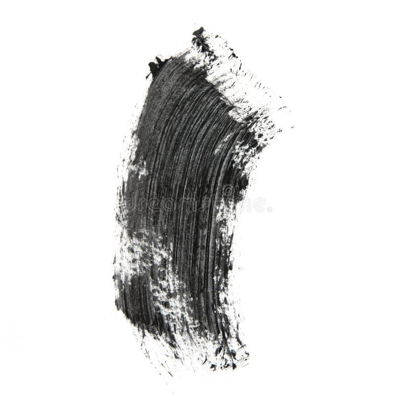 Colpi neri della spazzola della mascara isolati su bianco fotografia stock