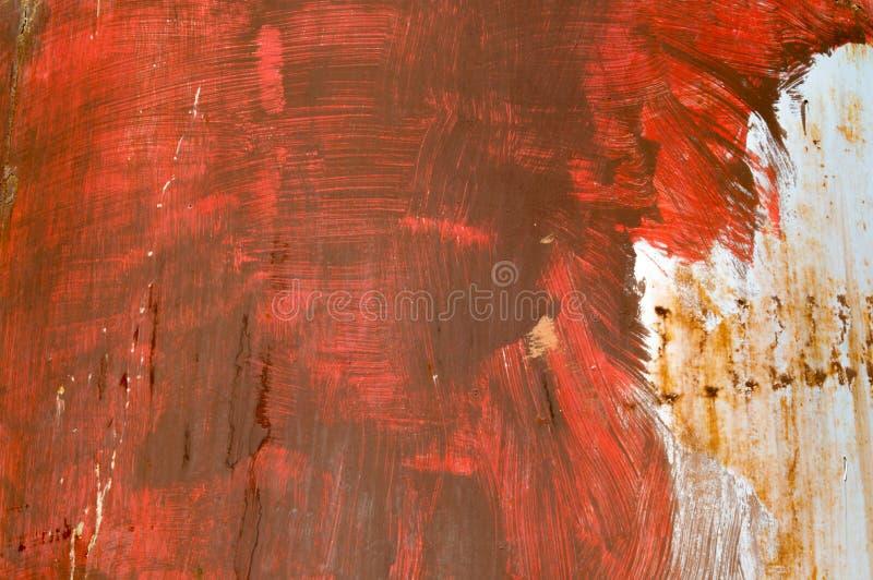 Colpi rossi audaci del pennello di struttura del fondo fotografia stock