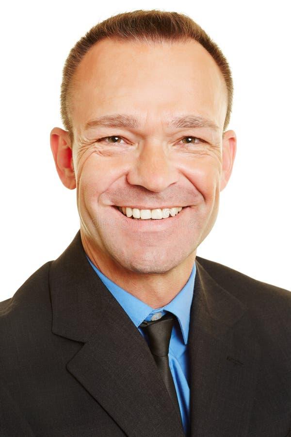Colpo capo dell'uomo d'affari sorridente immagine stock libera da diritti