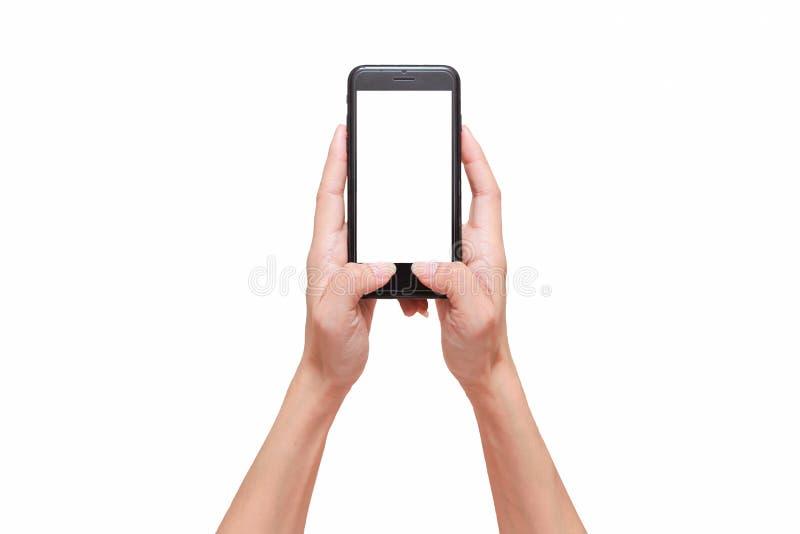 Colpo del primo piano di una donna che scrive sul telefono cellulare isolato su fondo bianco fotografie stock