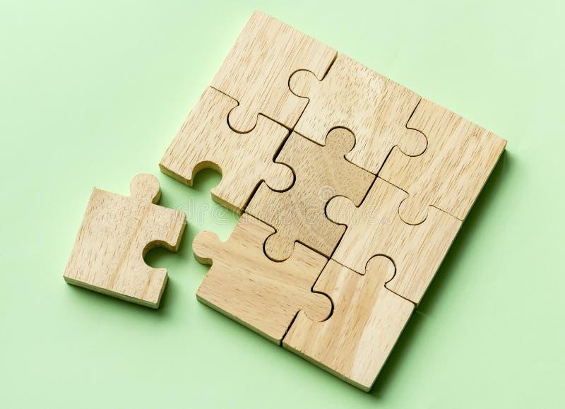 Colpo di macro di concetto di lavoro di squadra del puzzle fotografia stock libera da diritti