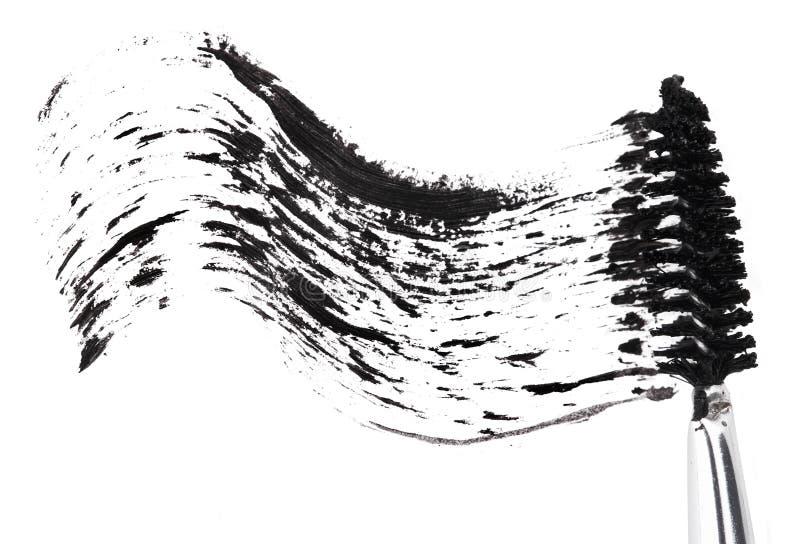 Colpo di mascara nera con la spazzola dell'applicatore fotografia stock libera da diritti