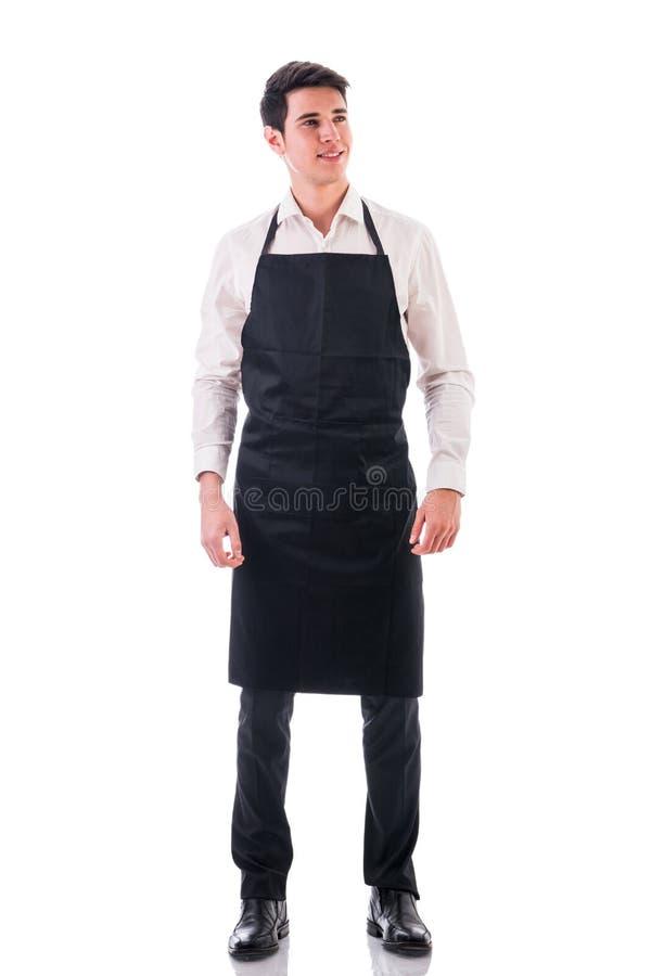 Colpo integrale di giovane posa del cameriere o del cuoco unico fotografie stock