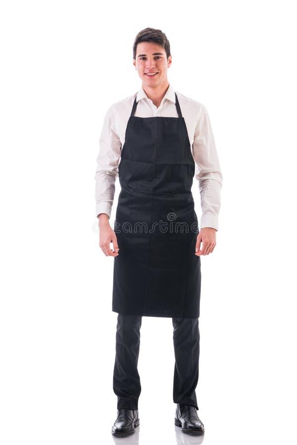 Colpo integrale di giovane posa del cameriere o del cuoco unico fotografia stock libera da diritti