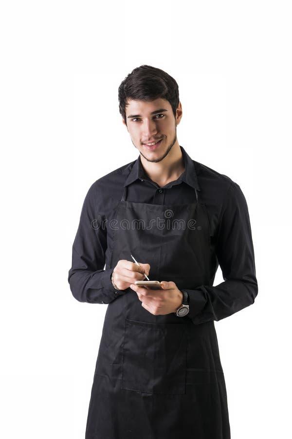 Colpo integrale di giovane posa del cameriere o del cuoco unico fotografia stock