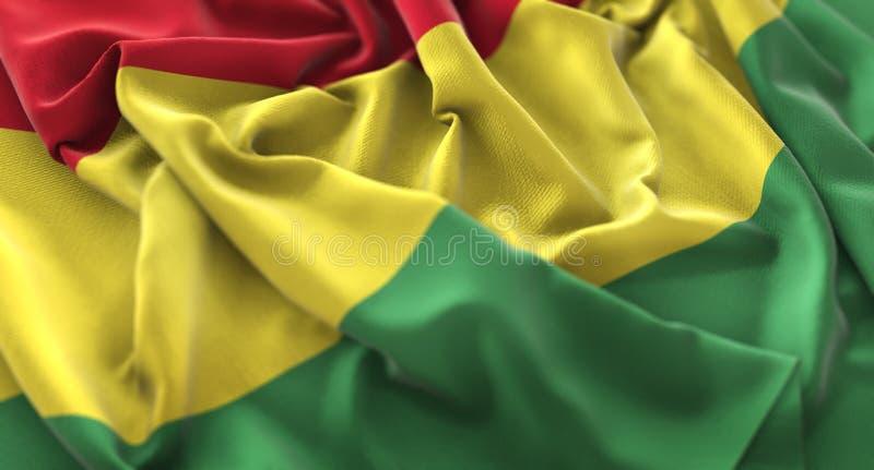 Colpo macro meravigliosamente d'ondeggiamento del primo piano increspato bandiera della Bolivia fotografia stock libera da diritti