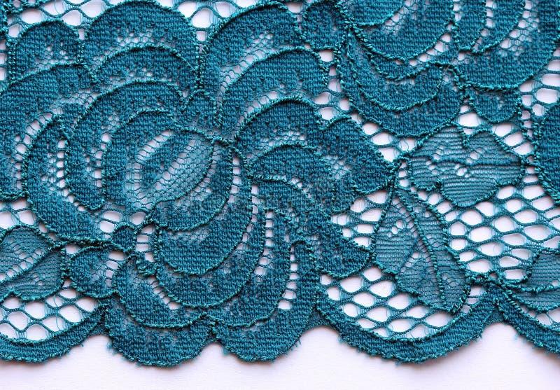 Colpo materiale di macro di struttura del pizzo blu dei fiori immagine stock libera da diritti