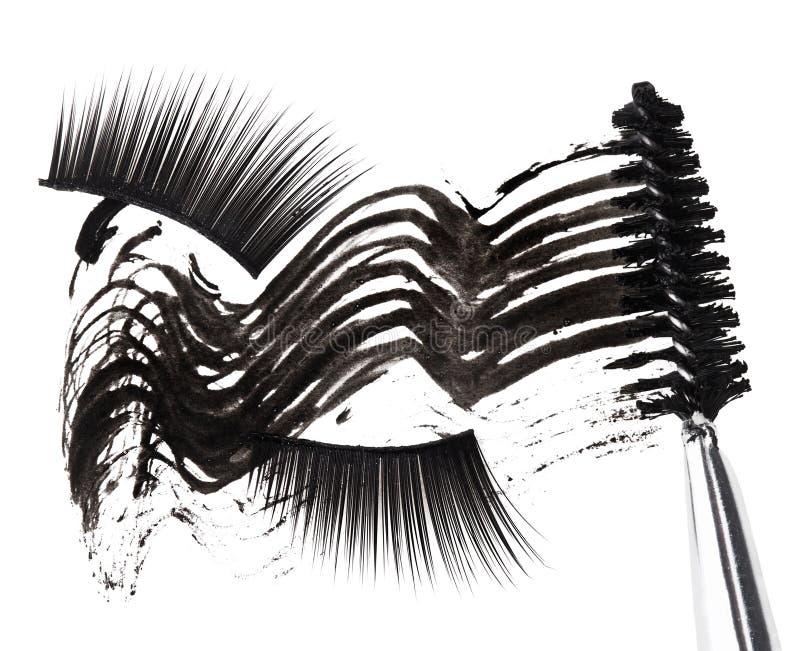Colpo nero della mascara, spazzola e cigli falsi immagini stock libere da diritti
