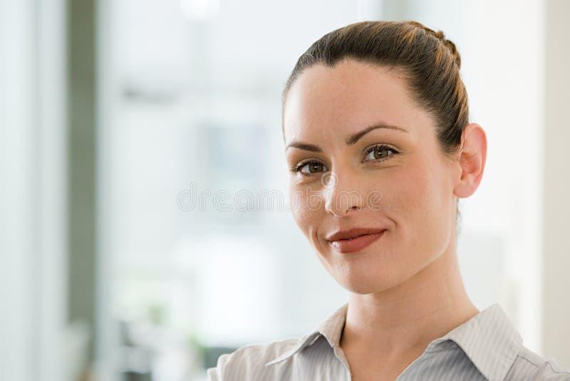 Colpo in testa di una donna di affari immagini stock