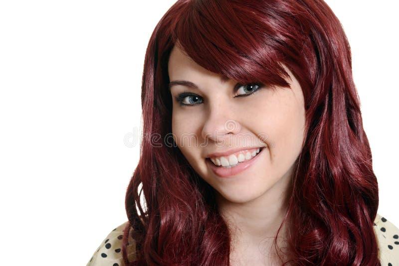 Colpo in testa teenager della testa felice di rosso fotografie stock