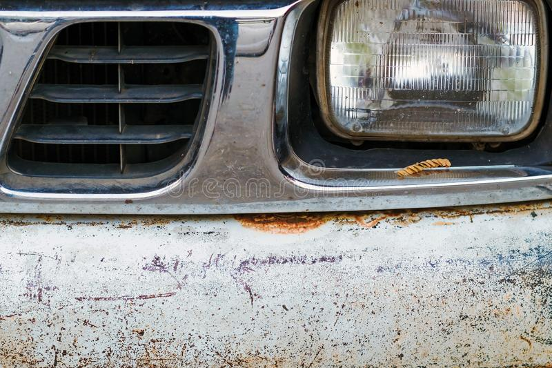 Colse up to decay and rust on the front bumper of an old white truck. stock photos