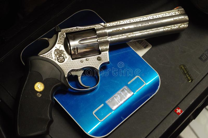 Colt Python 357 on a scale, beautiful powerful weapon royalty free stock photography