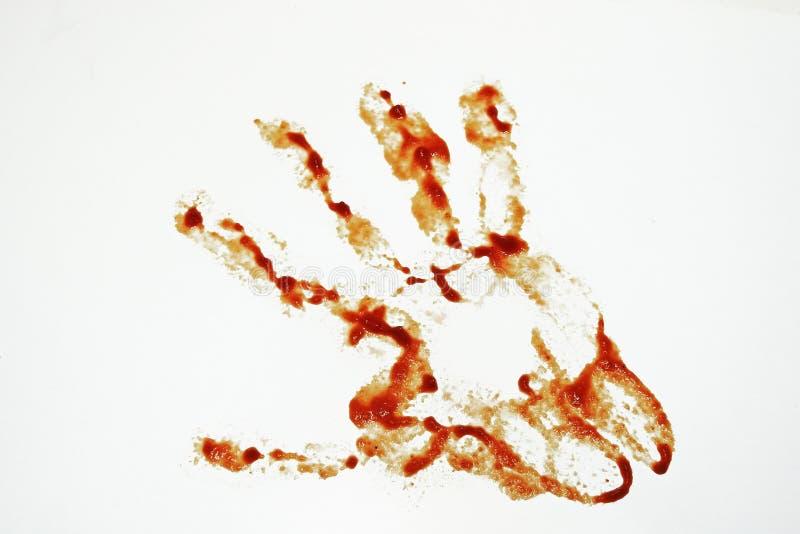 Coltello del metallo ed imitazione del sangue fotografia stock