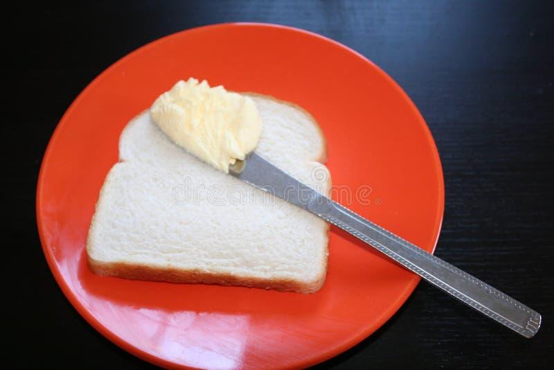 Coltello di burro e del pane immagini stock