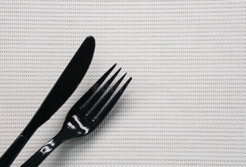 coltello e forcella neri fotografie stock