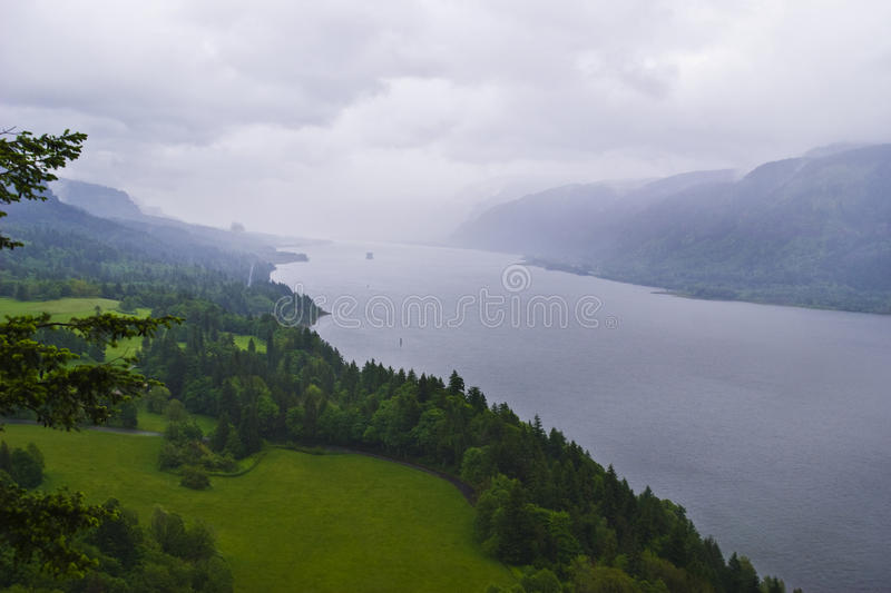 Columbia River Gorge. A foggy rainy day overlooking the Columbia River at the scenic area of Cape Horn Mountain basalt rocky royalty free stock image