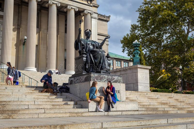 Columbia University Library buildings with columns and Alma Mater statue. NEW YORK, USA - OCTOBER, 2015: Columbia University Library buildings with columns and royalty free stock photography
