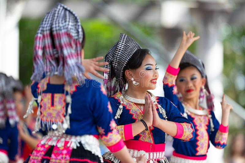 Asian Festival. Columbus, Ohio, USA - May 26, 2019: Columbus Asian Festival, Young girls performing Hmong traditional dances, in the amphitheater at Franklin royalty free stock photo