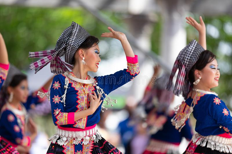 Asian Festival. Columbus, Ohio, USA - May 26, 2019: Columbus Asian Festival, Young girls performing Hmong traditional dances, in the amphitheater at Franklin stock images