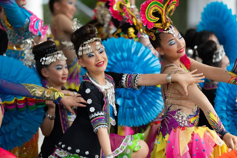 Asian Festival. Columbus, Ohio, USA - May 26, 2019: Columbus Asian Festival, Young girls performing Hmong traditional dances, in the amphitheater at Franklin stock image