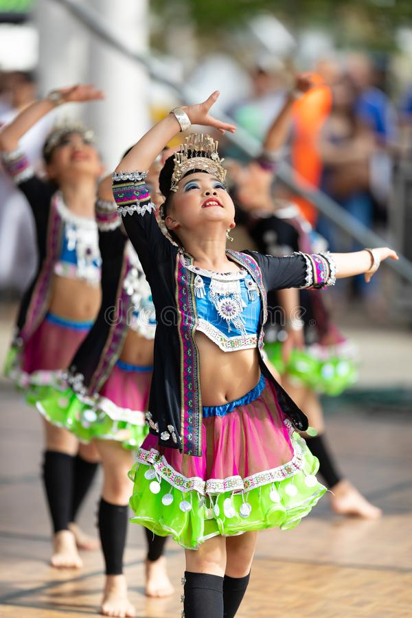 Asian Festival. Columbus, Ohio, USA - May 26, 2019: Columbus Asian Festival, Young girls performing Hmong traditional dances, in the amphitheater at Franklin stock photography