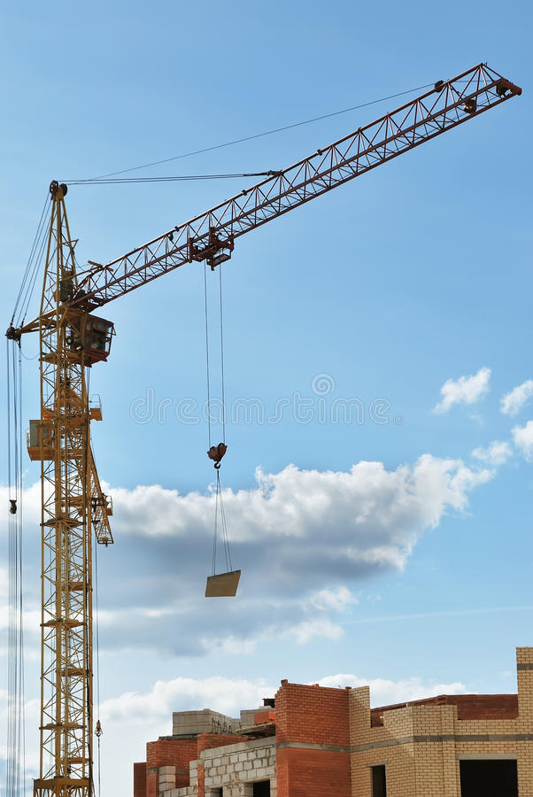 Column crane building a house royalty free stock images