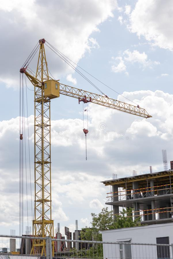 Column crane near unfinished construction. industry theme stock image