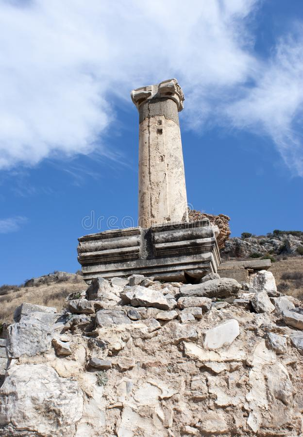 The Column of Ephesus Ancient Greek City. The lonely column in ruins of Ephesus ancient Greek city, the archaeological site in Turkey royalty free stock images