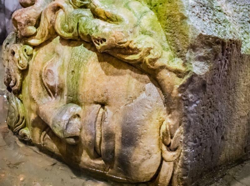 Column with inverted Medusa head base in Basilica Cistern. Istanbul. Turkey stock image