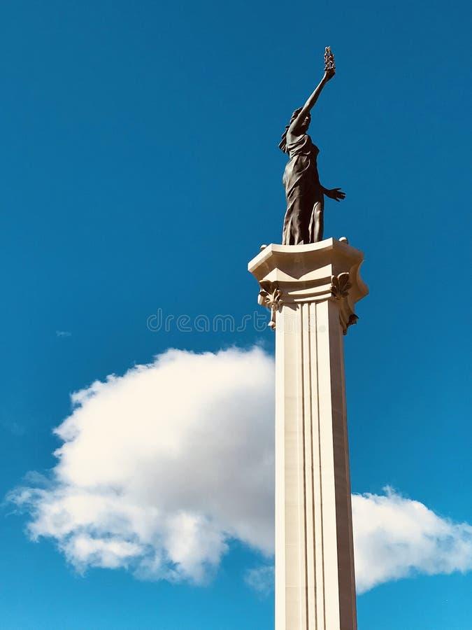 The column of Lady Victory in Irpin, Ukraine in glorious September sunshine - Kyiv - Ukraine - Irpin. The column of Lady Victory in Irpin, Ukraine in black & stock image