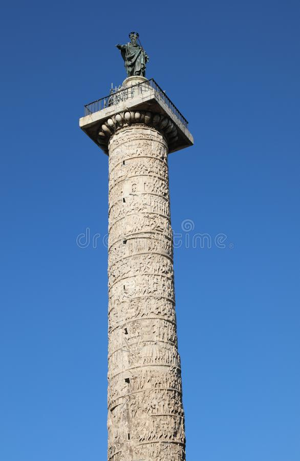 Column of Marcus Aurelius and Statue of Saint Paul in Rome royalty free stock photos