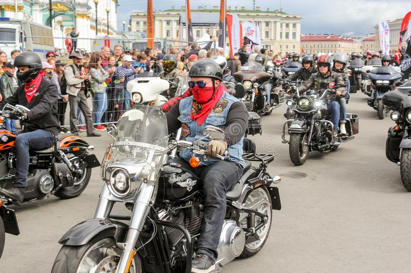 A column of motorcyclists rides start royalty free stock images