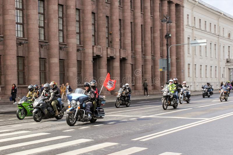 A column of motorcyclists at speed in motion stock image