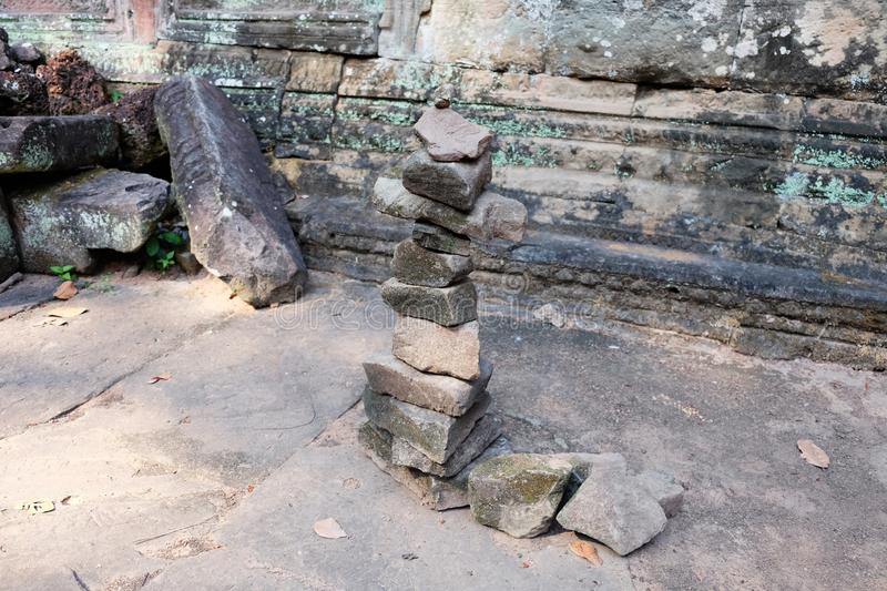 A column of pebbles among the ancient ruins. Ð¡olumn of stones.  stock photo