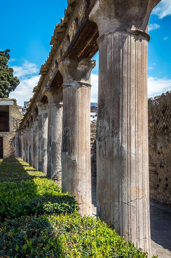 Column pillars at ruins of Herculanum which was covered by volcanic dust after Vesuvius eruption, Herculanum Italy royalty free stock photos