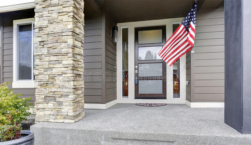Column porch of luxurious house with American flag royalty free stock photo